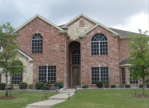 Large arched windows, black solar screens, white grids